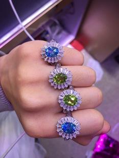 天然925银镶嵌瑞士蓝托帕石戒指 橄榄石高档时尚椭圆型指