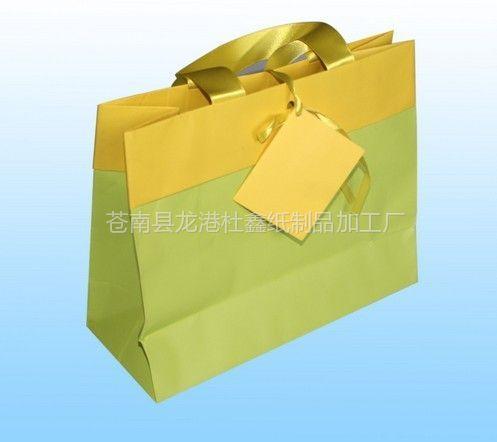 供应2013袋子批发厂家供应优质纸袋卡纸袋、牛皮纸袋服装包装袋定做
