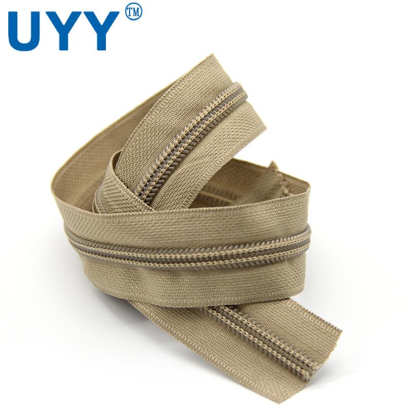 UYY拉链厂家定制开尾浅棕色5#尼龙拉链卷服装专用码装长链款拉链
